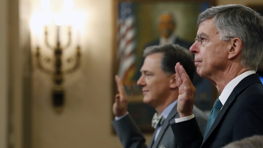 Top U.S. diplomat to Ukraine William Taylor (right) and Deputy Assistant Secretary for European and Eurasian Affairs George Kent are sworn in to testify before the House Intelligence Committee on Wednesday.