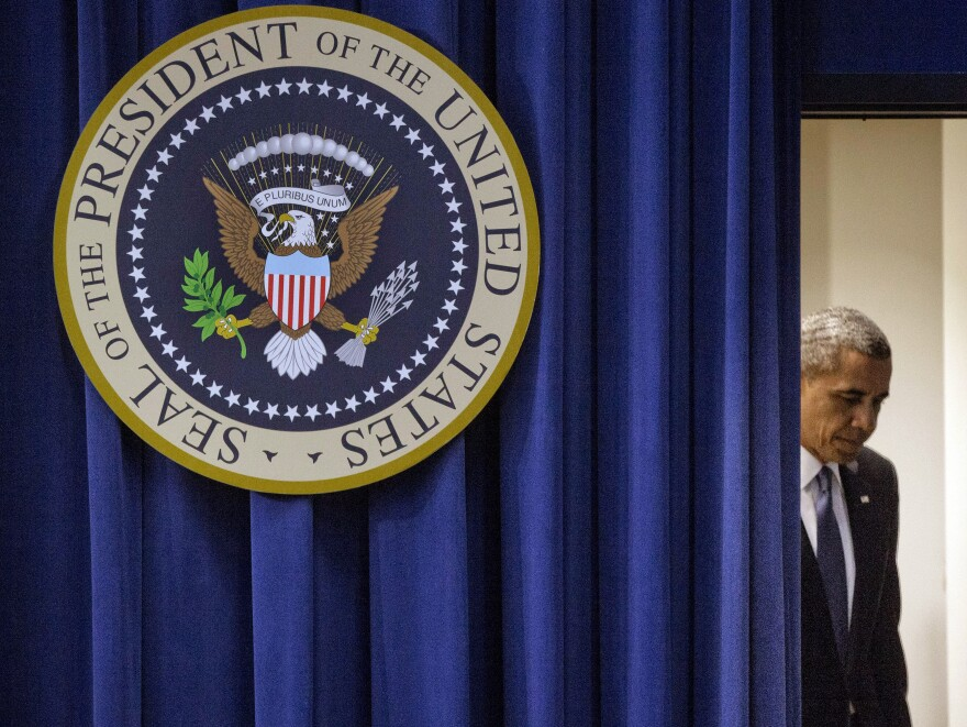 President Obama walks out to deliver remarks on the economy at the White House on Monday. At the beginning of his news conference, Obama commented on the shootings at the Navy Yard.