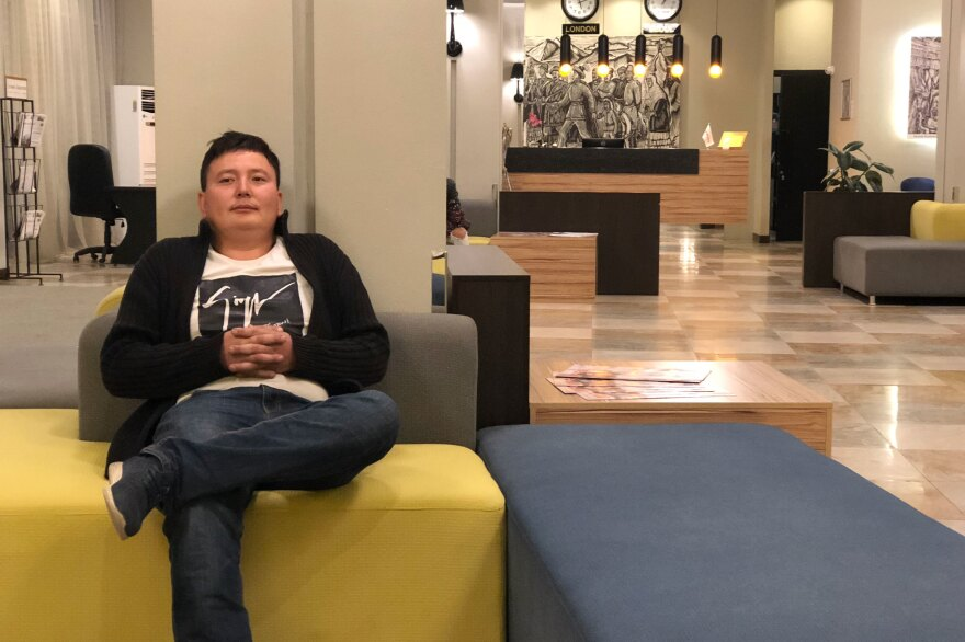 Chinese citizen Kayrat Samarkand, pictured in a hotel in Almaty, Kazakhstan, says he was detained in a Chinese re-education camp in his home region of Xinjiang for months. He says he was tortured and finally released after trying to kill himself.