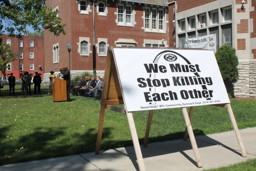 A sign, printed by Better Family Life, stands outside their offices on Page Blvd. during a press conference.