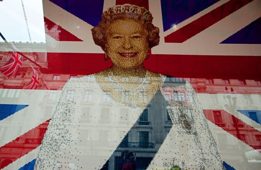 A flag with Queen Elizabeth II's portrait made entierly of Legos is pictured in the window of a shop in central London.