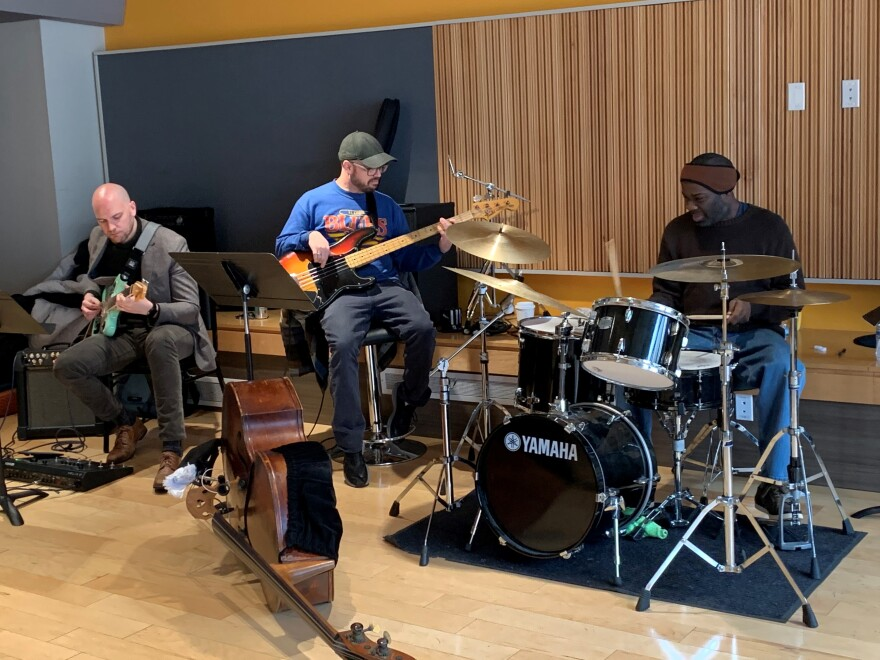 """Guitarist Travis Lewis, bassist Bob DeBoo and drummer Montez Coleman rehearse for a one-night tribute to """"Bitches Brew."""" [2/12/20]"""