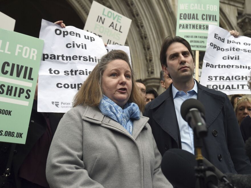 """Rebecca Steinfeld, left, and Charles Keidan, shown outside London's Royal Courts of Justice in 2017, wanted their relationship recognized in law without the """"patriarchal baggage"""" of marriage. They said they faced discrimination because only same-sex couples were eligible for civil partnerships."""