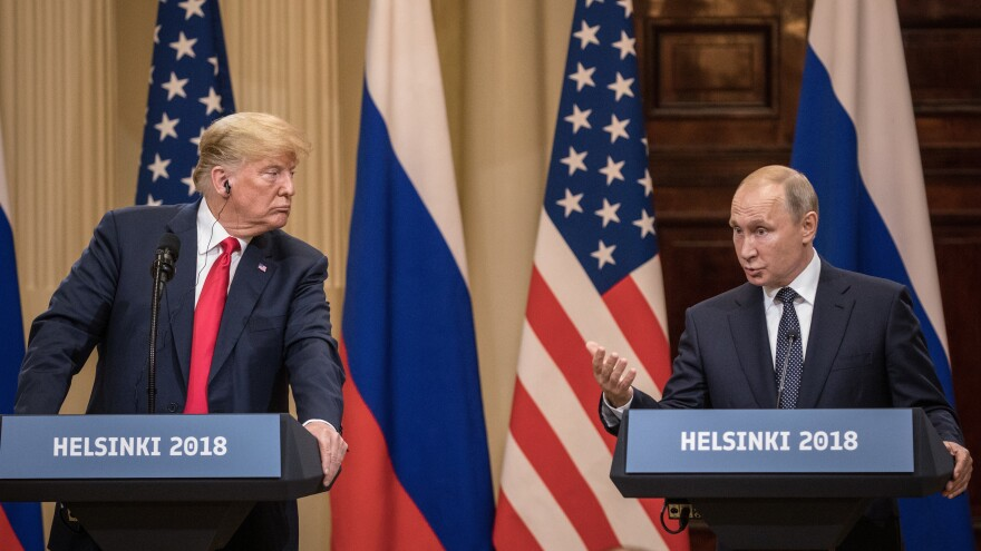 President Trump and Russian President Vladimir Putin answer questions during a joint news conference after their summit on July 16 in Helsinki.