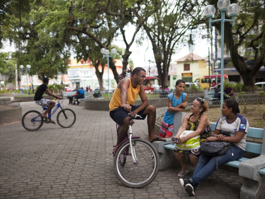 Residents socialize and children play in the tranquil plaza of Mage, a small town that has seen an increase in violence as pacification efforts in Rio de Janeiro are forcing drug traffickers out of the capital's <em>favelas,</em> or shantytowns.