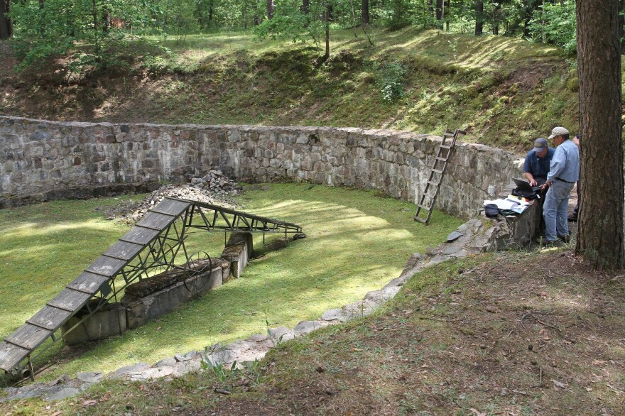 This is where the Burning Brigade was housed. The apparatus in the middle is not the original, but ones like it were used as ramps so that the bodies could be stacked high and set alight. All the pits at Ponar were originally dug by the Russians to store fuel.