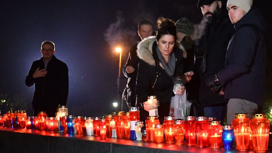 Residents of the Bosnian city of Mostar light candles Wednesday night in tribute to convicted war criminal Slobodan Praljak.