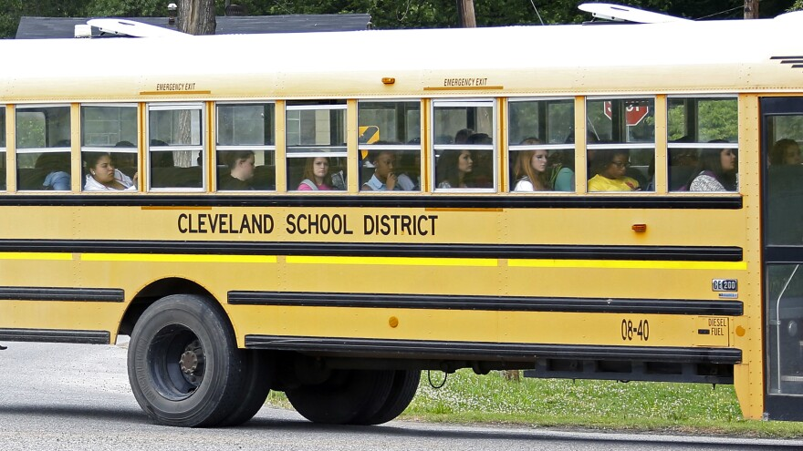 Public school students in Cleveland, Miss., ride the bus on their way home following classes in May 2015.