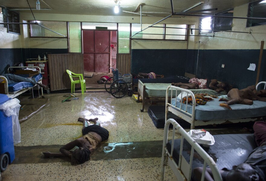 Two people lie dead on the floor inside the critical ward of the Redemption Hospital, which has become a transfer and holding center for Ebola patients, located in one of the poorest neighborhoods of Monrovia.