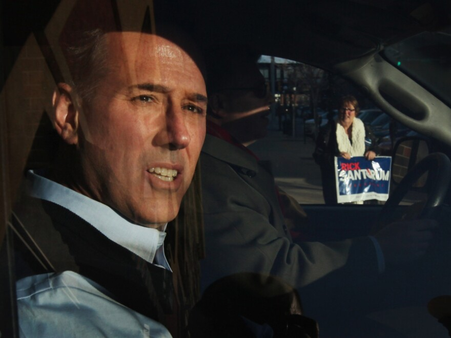 Santorum leaves a campaign stop at the Daily Grind coffee shop in Sioux City, Iowa, on Jan. 1.