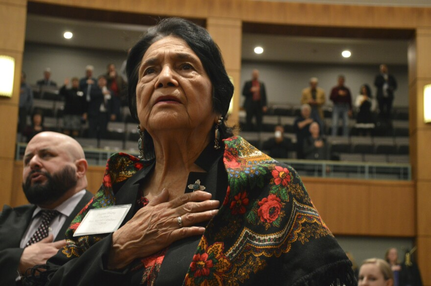 Dolores Huerta stands for the Pledge of Allegiance in Spanish at the New Mexico Statehouse on Feb. 27, 2019.