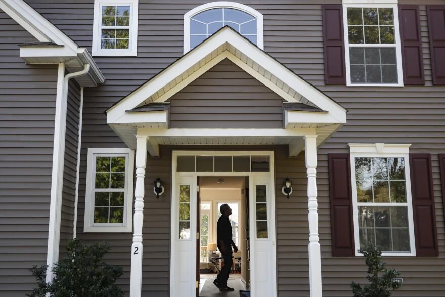 A man tours his new home (John Minchillo/AP)