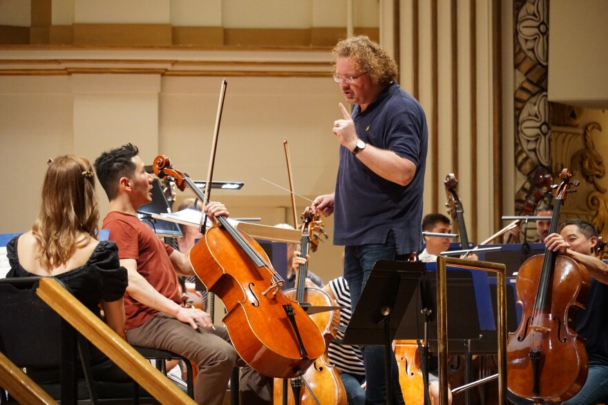 Stéphane Denève works with orchestra members during a rehearsal at Powell Hall. [9/26/19]