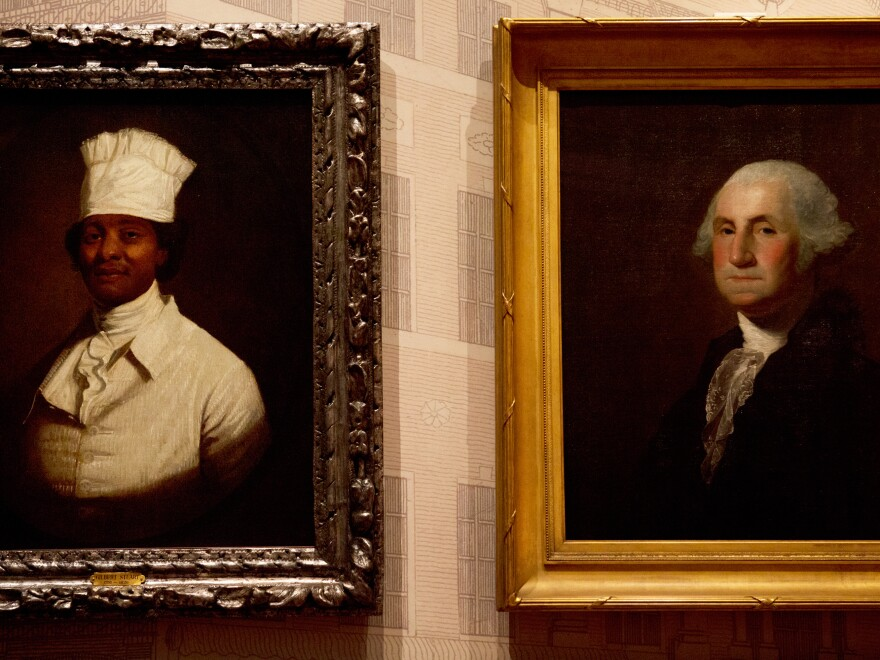 Gilbert Stuart's famous portrait of George Washington is displayed next to another portrait by Stuart that is believed to be Hercules, George Washington's cook. Hercules was with Washington during his presidency.