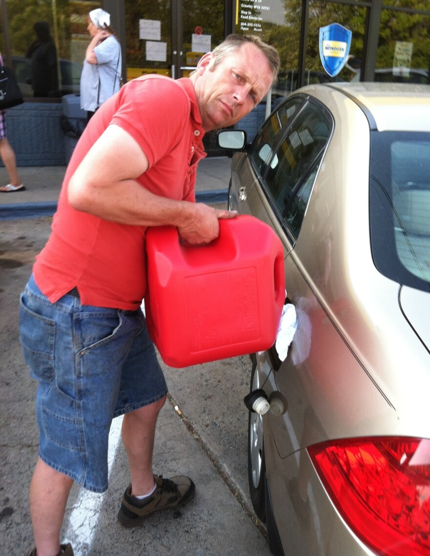 """Trucking company owner Tod Moss, who lives in the town of Beckley, drove 40 miles to Crawley to bring a few gallons of gas to his employees. """"You could get beat up and killed for 5 gallons of gas,"""" he says."""