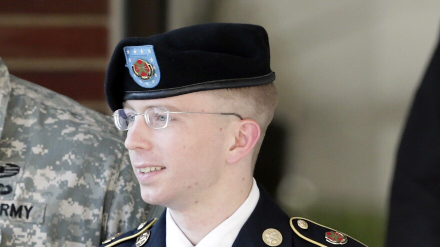 Army Pfc. Bradley Manning is escorted out of a courthouse in Fort Meade, Md., after a pretrial hearing in June. Manning is charged with aiding the enemy by giving hundreds of thousands of classified diplomatic cables and war logs to the secret-sharing website WikiLeaks.