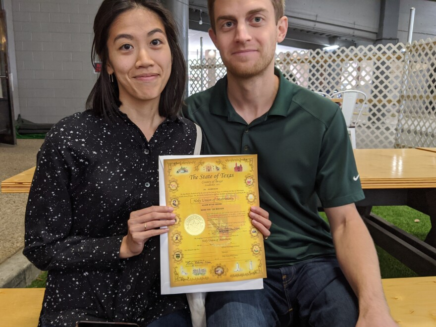 Thu Nguyen and Allen Gross were able to get their marriage license in San Antonio — but coronavirus restrictions have disrupted their wedding plans.