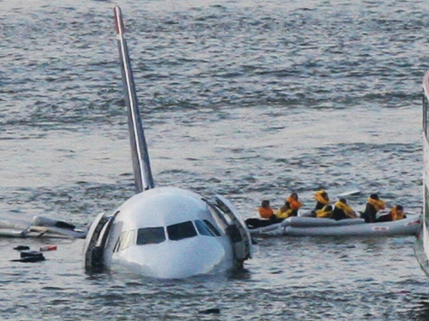 """Jan. 15, 2009: As the U.S. Airways jet they had been on sinks into the Hudson River, passengers are rowed away. This isn't <a href=""""https://twitter.com/jkrums/status/423458459737419777"""">the iconic (and now copyrighted) photo</a> that helped transform Twitter. But it does give a sense of what it was like that day, 5 years ago."""