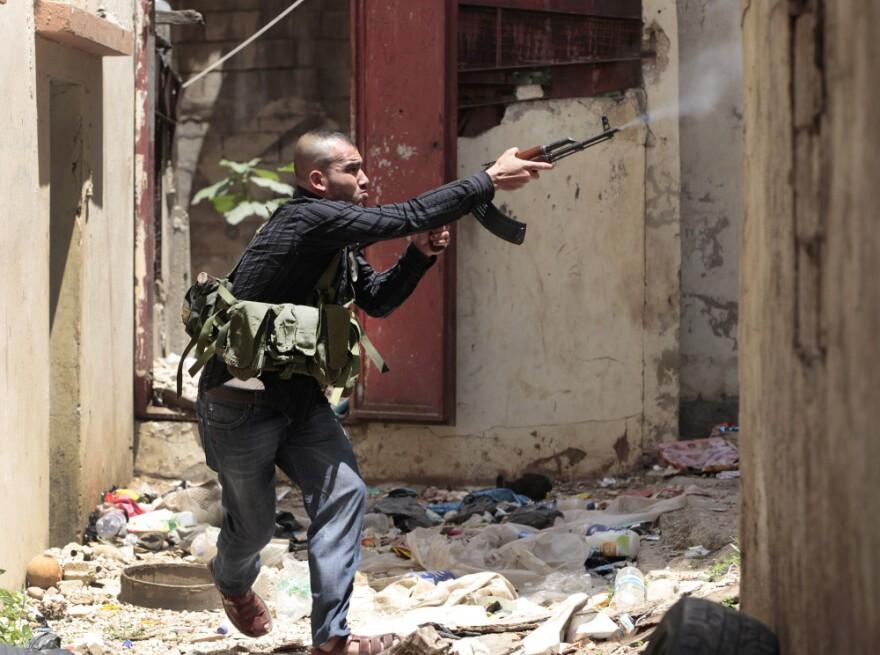 A Sunni gunman fires during clashes in the northern port city of Tripoli, Lebanon on Monday.