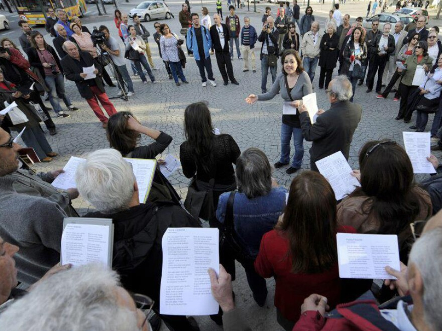 Pinto conducts members of the Intervention Choir of Porto, a choral group she founded to use music as a form of nonviolent civil disobedience. They perform at protests nationwide.