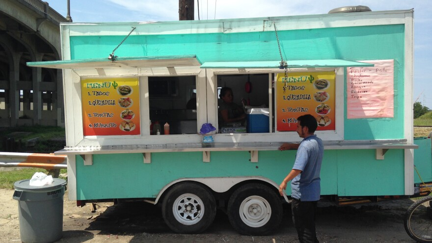 <em>Taqueria La Delicia</em> is a <em>lonchera</em>, or food truck, that parks near a Lowe's Home Improvement store in New Orleans. The owner is Honduran, and so are many of the day laborers who eat there.
