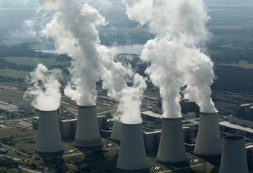 Steam rises from cooling towers at the Jaenschwalde coal-burning power plant on Aug. 20, 2010 near Cottbus, Germany. (Sean Gallup/Getty Images)