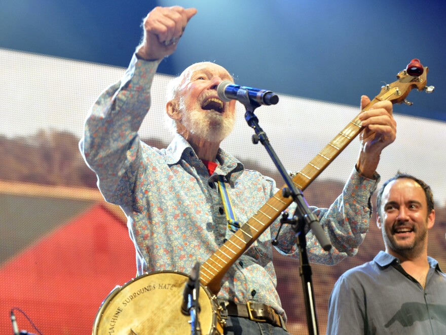 Pete Seeger performs on stage during the Farm Aid 2013 concert at Saratoga Performing Arts Center in Saratoga Springs, N.Y.