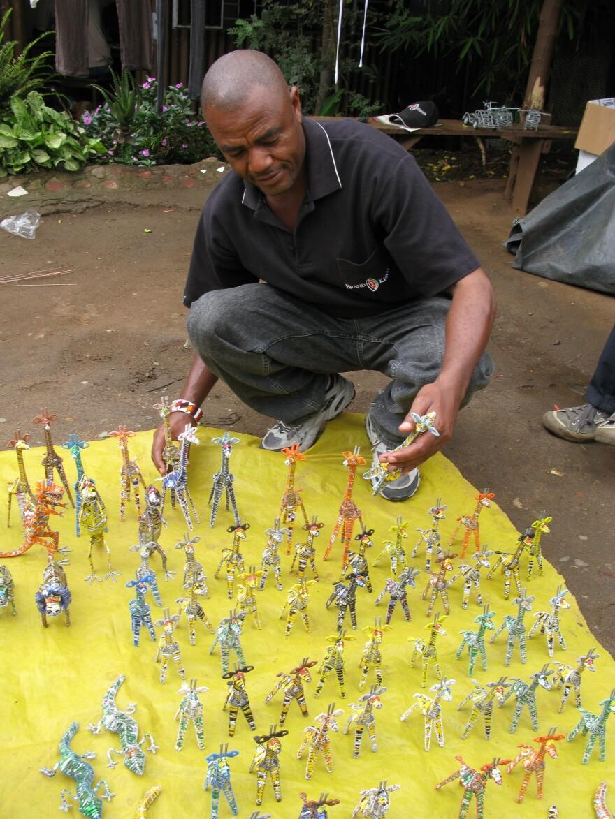 John Mucheru of Zakale Creations poses with his jewelry designs in Nairobi's Huruma slum.