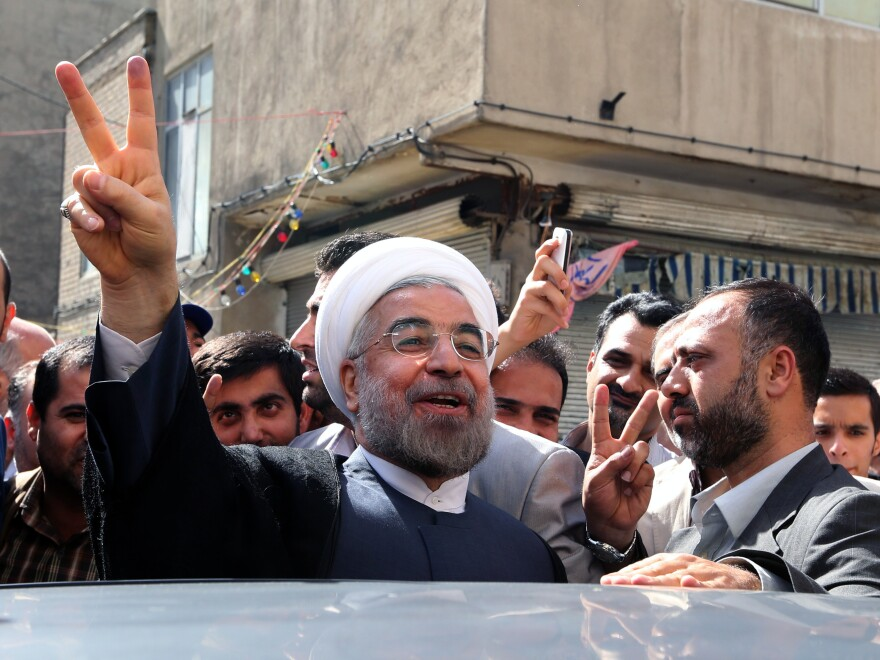 Moderate presidential candidate, Hasan Rowhani, a former nuclear negotiator, flashes the victory sign as he leaves a polling station in Tehran on Friday.