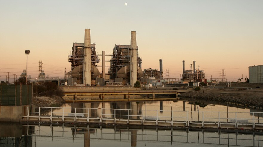 A new law in California, which goes into effect in January 2013, will put a cap on the amount of greenhouse gases coming from vehicles and industry. Above, the Alamitos natural gas-fired power station in Long Beach, Calif.