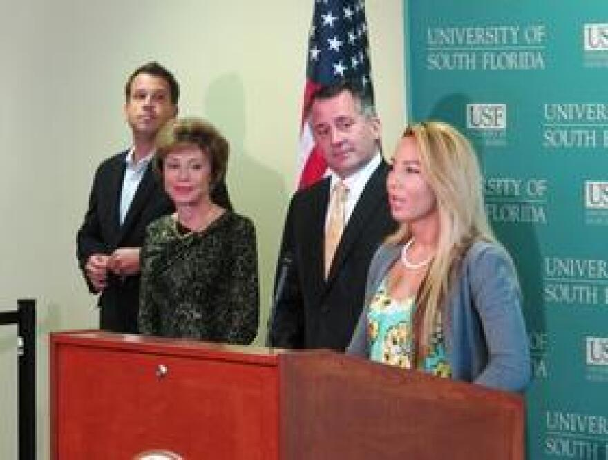 Caridad Jimenez speaks about her injured sister, Barbara, at a news conference Aug. 26 as Dr. Carlos Smith of JET I.C.U, USF President Judy Genshaft and Cong. David Jolly look on.