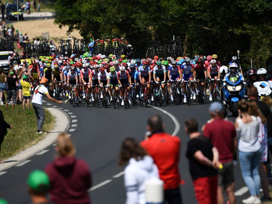 Spectators watch cyclists compete in the fourth stage of the Tour de France in eastern France last July. Organizers say the 2020 race will begin in late August.