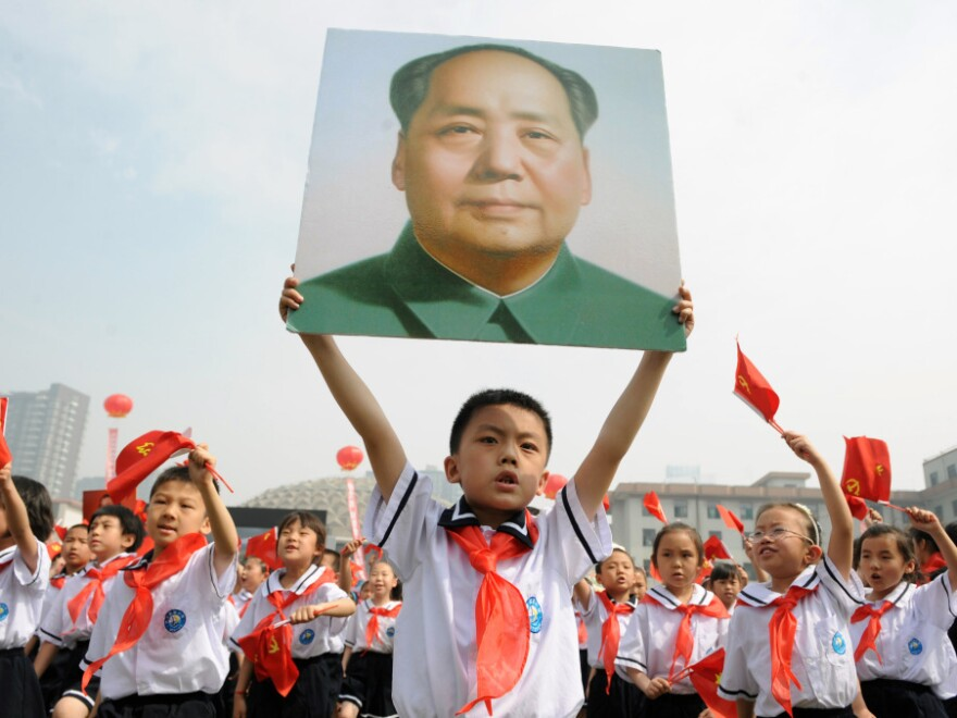 Thousands of Chinese students holding Communist flags and a portrait of China's late leader Mao Zedong mark the 90th anniversary of the founding of China's Communist Party. Celebrations like this one come during a controversial moment, as leftist groups push back at criticism of Chairman Mao and the millions of deaths he caused.