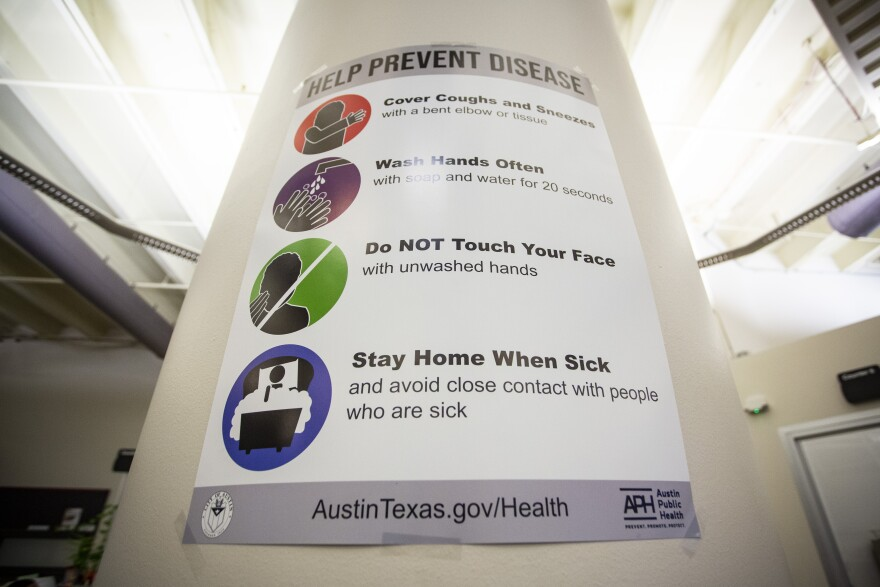 A sign from Austin Public Health encourages people to stay safe during the pandemic.