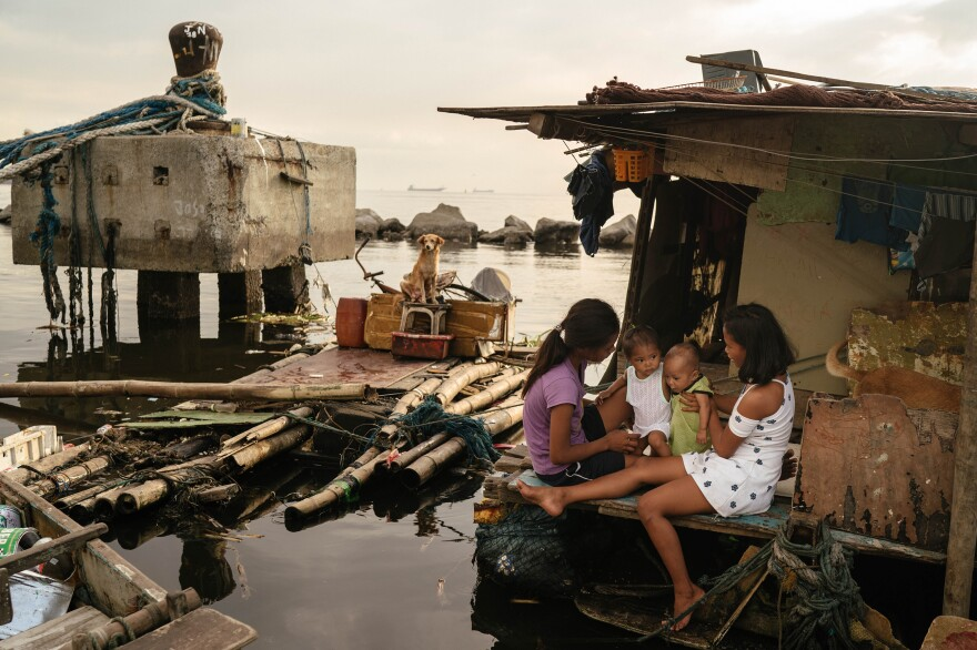 Sisters Joan (left) and Jossa Garcia (right), both teen mothers, are seen in their home in the Navotas fish port with their children, Angela and JM, respectively.