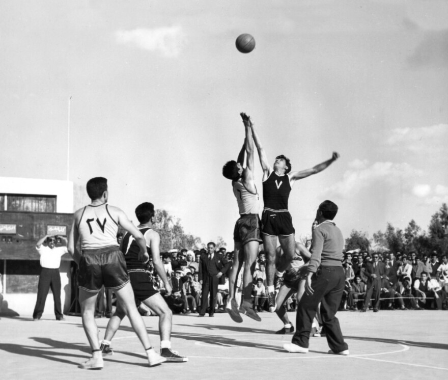 Students play a basketball game on the campus of Iraq's Baghdad College, in this undated photograph.