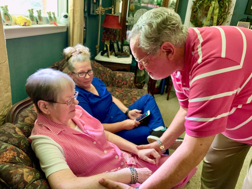 John McCasland (right) of Goodlettsville, Tenn., hired a private caregiver to help with his wife, Jean (left), who suffered from dementia for eight years. Even when hospice took over, he still found he needed the extra help from Karrie Velez (center). Jean died in October after 13 months on home hospice.