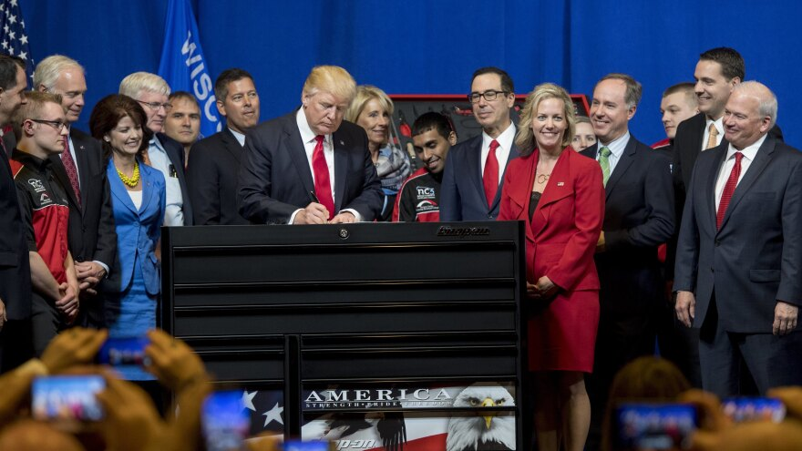 "President Trump signs a ""Buy American, Hire American"" executive order at Snap-On Tools in Kenosha, Wis., back in 2017."