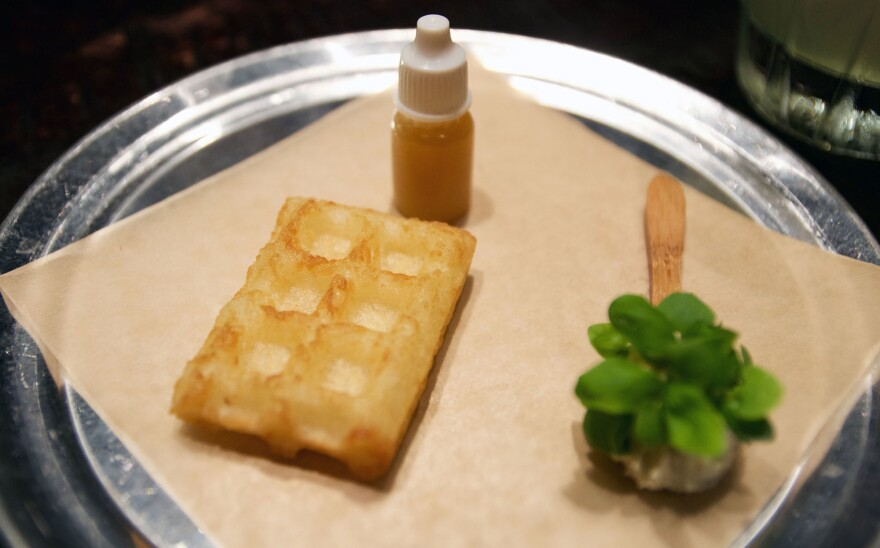 """Chef Jose Carles' """"Namffle,"""" his spin on the waffle, replaces wheat flour with nampi, a vegetable. It is served with a side of plum syrup and spicy basil yogurt."""