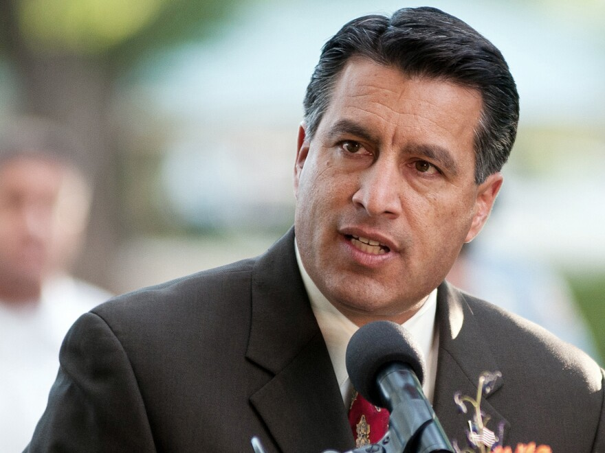 A bill that would allow Nevadans without insurance to buy into Medicaid starting in 2019 awaits Gov. Brian Sandoval's signature or veto.