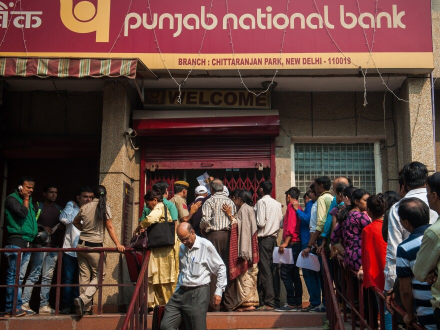 People line up outside a bank to exchange old currency notes with new ones on November 10, 2016 in New Delhi India.