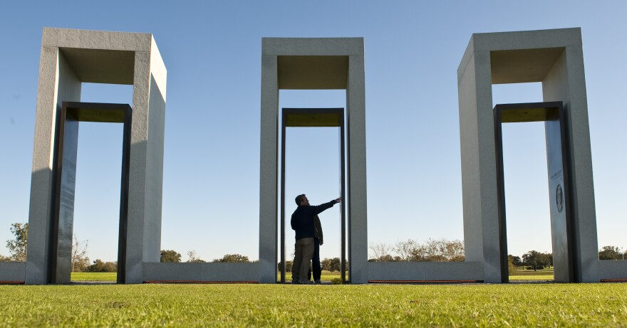 In this 2009 file photo, Texas A&M University medical student Cody Chambers stands at the Texas A&M Bonfire Memorial in College Station. Nov. 18 marks the 20th anniversary of the accident, in which the 59-foot tower of logs collapsed.