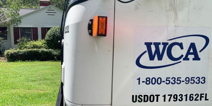 WCA truck stops in front of a Gainesville house for curbside pickup.