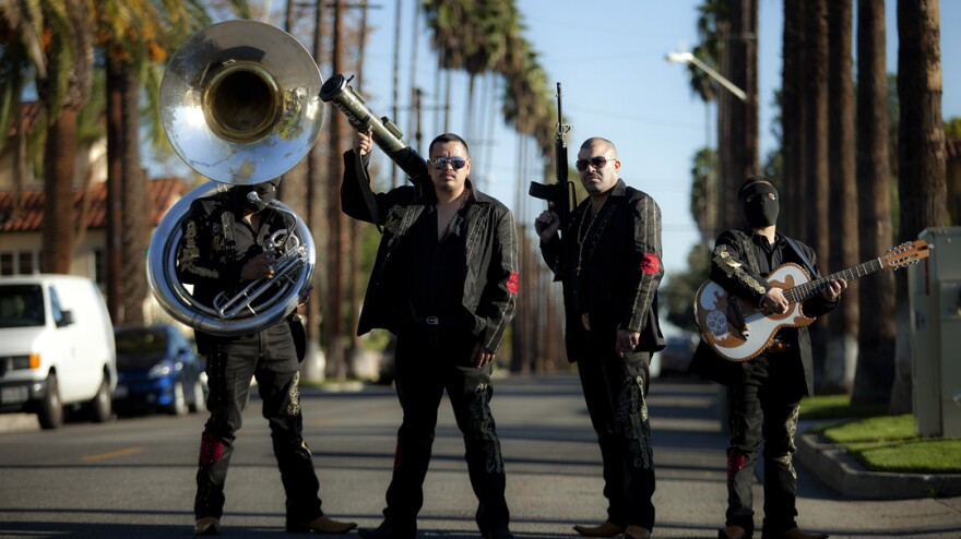 In <em>Narco Cultura</em>, director and photojournalist Shaul Schwarz interrogates the collision of pop culture and Mexico's drug cartels — as personified by bands like Los Bukanas de Culiacan (above), who perform <em>narcocorridos</em>, or songs glorifying the drug trade.
