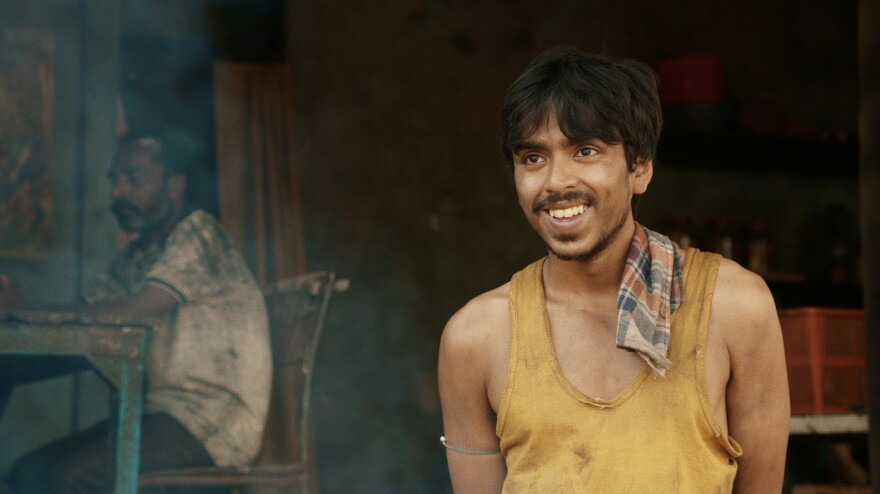 "He is ""the white tiger"" — a poor villager, Balram, portrayed by actor Adarsh Gourav, who is determined to use his intelligence to escape a life of poverty."