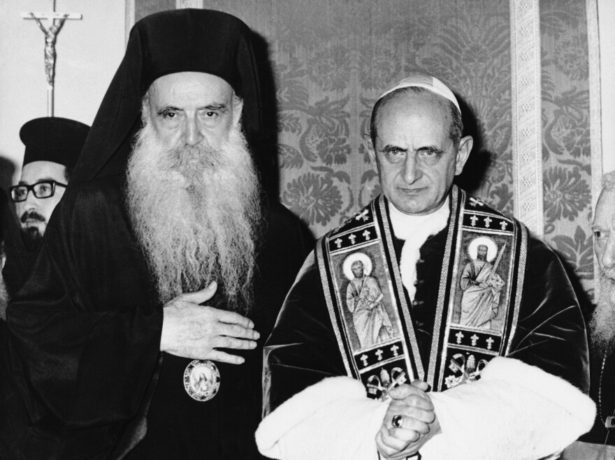 Pope Paul VI of the Roman Catholic Church and bearded Orthodox Patriarch Athenagoras of Constantinople pose during a historic meeting on Jan. 8, 1964, on the Mount of Olives in a part of Jerusalem that was controlled by Jordan at the time. It was the first meeting between leaders of the split church since the East-West Schism of 1054.