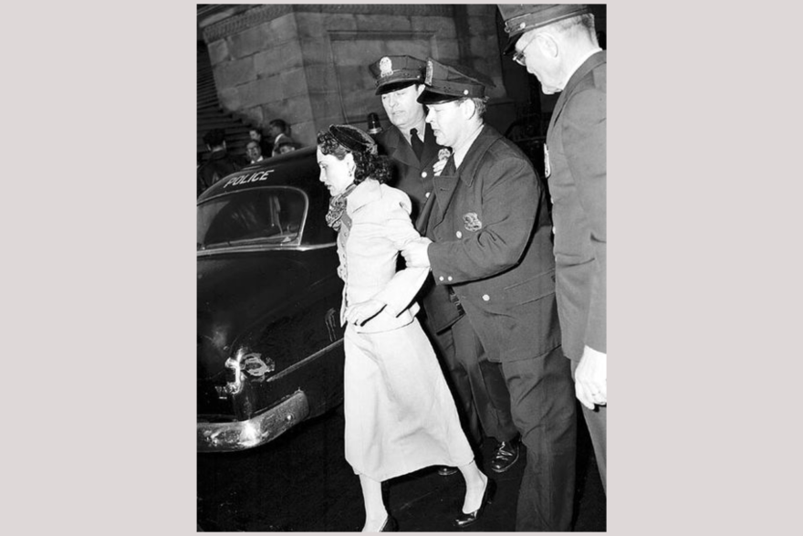 Puerto Rican nationalist Lolita Lebrón being led by police into a police care in 1954