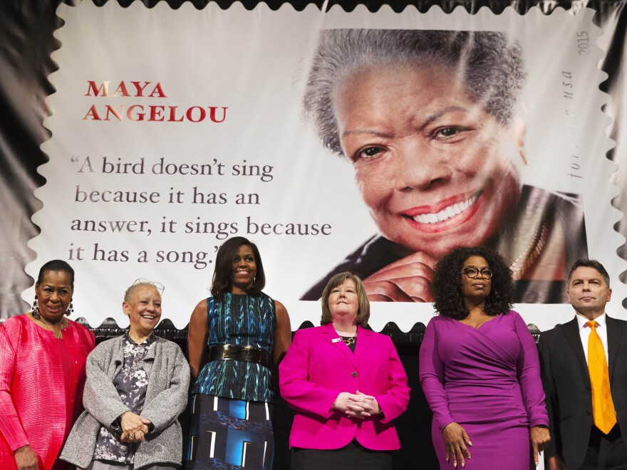 First lady Michelle Obama and Oprah Winfrey, among other distinguished presenters, attend the unveiling of the Maya Angelou Forever Stamp on Tuesday.