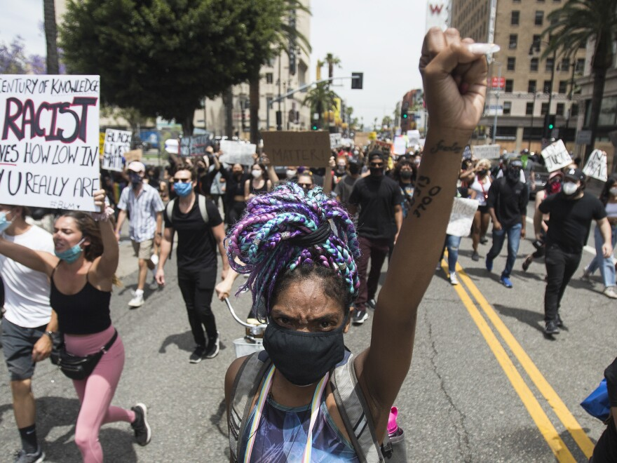 Demonstrators take part in a protest Tuesday in the Hollywood neighborhood of Los Angeles over the death of George Floyd.