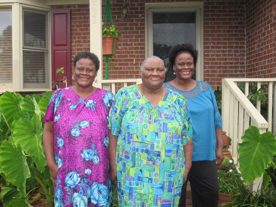 Alberta Currie, 78, is flanked by her twin daughters, Brenda Bethea (left) and Linda Blue, outside their house in Hope Mills, N.C. Currie says she has voted at polling places since 1956, despite literacy tests and daylong waits in the days before the Voting Rights Act. Under North Carolina's new voter ID law, Currie will have to vote absentee if at all, because she can't get a state photo ID.